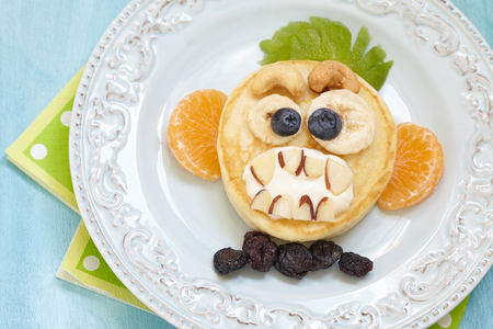 Funny Halloween pancake with scary monkey face