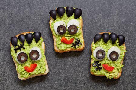 Avocado toast look like as green monster for Halloween Stockfoto