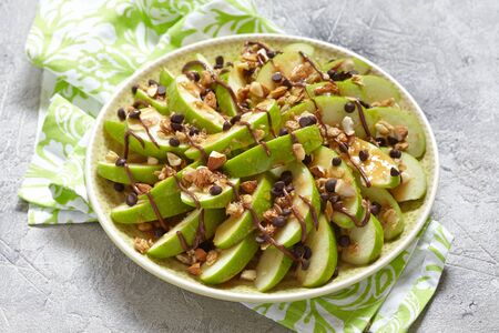 loaded: Loaded apple nachos with caramel, chocolate chips, granola and almonds