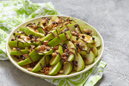 chocolate treats: Loaded apple nachos with caramel, chocolate chips, granola and almonds