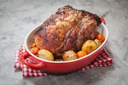 Boneless Pork Loin Roast with Potatoes and Tomatoes Archivio Fotografico
