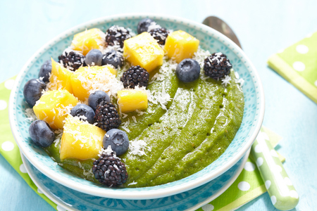 shreded: Breakfast green smoothie bowl topped with mango, bluebery and blackberry