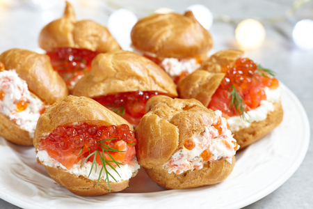Profiteroles with salmon, red caviar and cheese cream Stock Photo