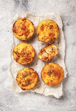 muffin: Delicious breakfast egg muffins with sausage, bacon, baked beans and hash brown