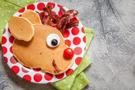bacon art: Christmas fun food for kids. Rudolph reindeer pancake for breakfast Stock Photo