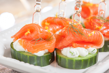 dill: cucumber canape with dill cream cheese and smoked salmon appetizer Stock Photo