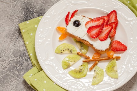 Kids breakfast toast with fruit and cream cheese