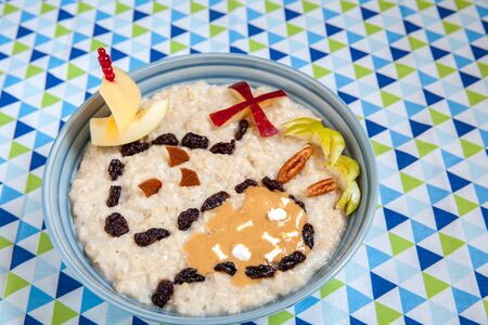 Oatmeal porridge decorated with a fruity pirate treasure map