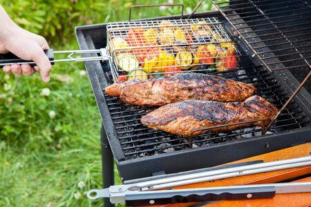 pork tenderloin and vegetables on the grill