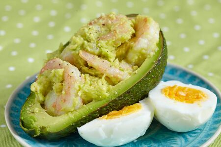 mediterranian: Stuffed avocado with garlic shrimp Stock Photo