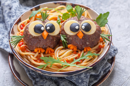 Pasta spaghetti with funny meatballs for kids