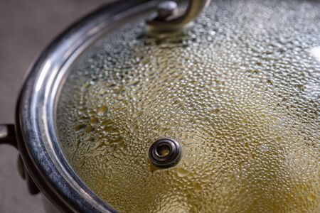 condensate: cooking in pot pan with cover on stove