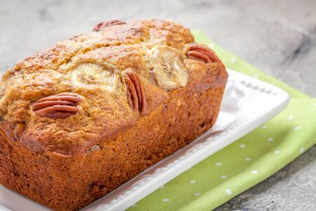 pecan: Sliced banana bread with a pecan nuts