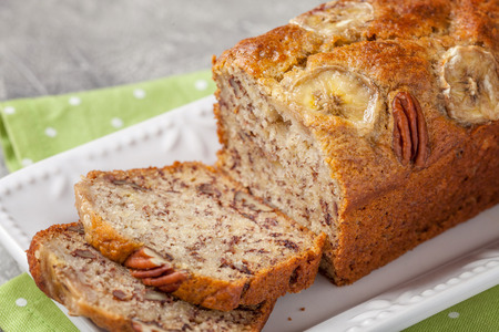 Sliced banana bread with a pecan nuts