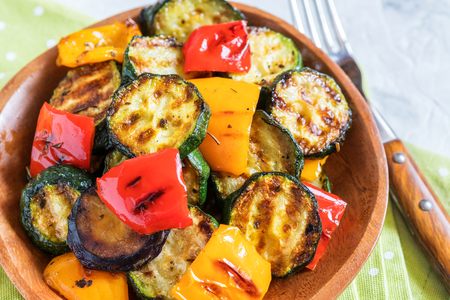 Grilled vegetables salad with zucchini, eggplant, onions, peppers and herbs Stock Photo