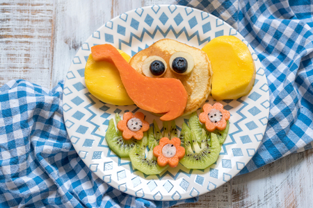Funny elephant pancakes for kids breakfast Standard-Bild