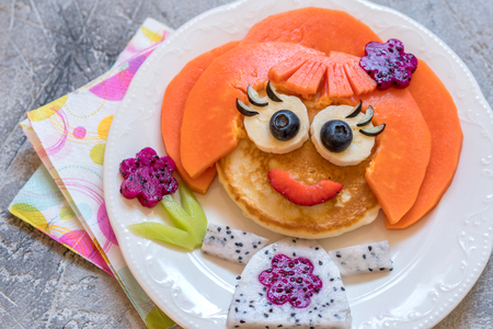 Funny girl pancake face with fruits Stock Photo