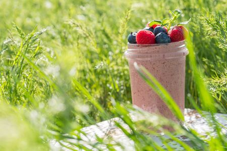 Overnight breakfast oats smoothie with raspberries and blueberies Stock Photo
