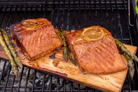 cedar plank salmon with lemon on a grill