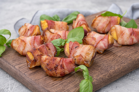 Grilled bacon wrapped peach with balsamic vinegar