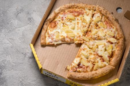 Hawaiian pizza in box on table, closeup