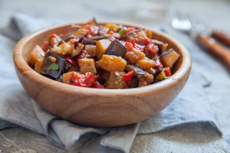 Eggplant stewed saute with fresh vegetables and herbs Standard-Bild