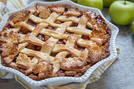 Traditional American Apple pie with fall autumn leaves food decoration
