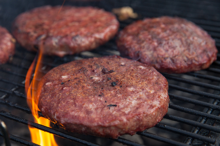 Beef or pork meat barbecue burgers for hamburger prepared grilled on flame grill