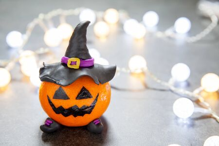Halloween pumpkin tangerine with black witches hat Stock Photo