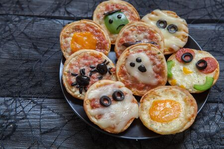 mini jack: Mini pizzas decorated for a Halloween
