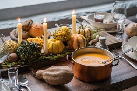 Autumn table setting with pumpkins. Thanksgiving dinner and fall decoration. Stock Photo