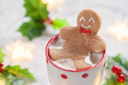 Hot white chocolate with funny gingerbread man Stock Photo