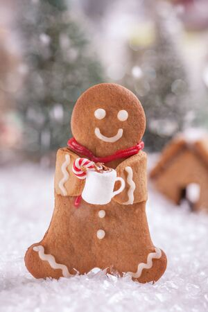 Funny Gingerbread cookie men with marshmallow snowman Stock Photo