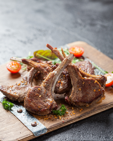 Roasted lamb ribs with spices and greens