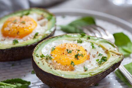 Eggs baked in avocado Stock Photo
