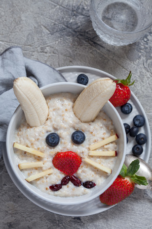 Funny bunny oatmeal bowl with fruits Stock Photo