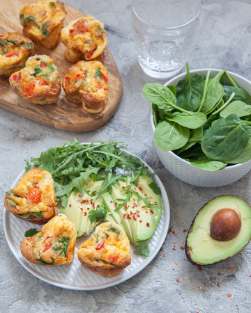 Delicious egg muffins with ham, cheese and vegetables. healthy breakfast