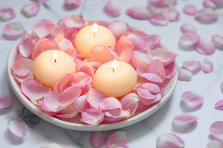 Pink roses and candles Stock Photo