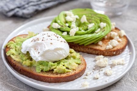 healthy breakfast toasts with avocado and egg