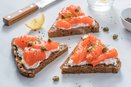 Smorrebrod, traditional Danish open sanwiches, dark rye bread with salmon, cream cheese and capers.