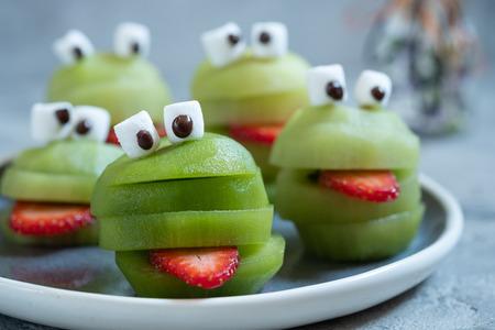 Spooky green kiwi monsters for Halloween Stock Photo