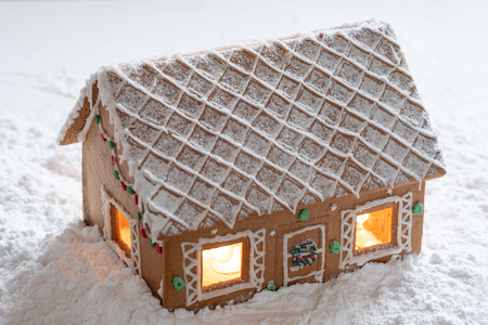 Gingerbread house in snow