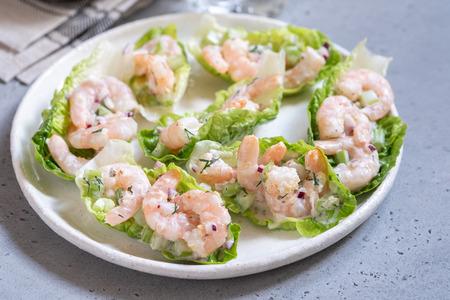 Shrimp salad wraps in lettuce leaves