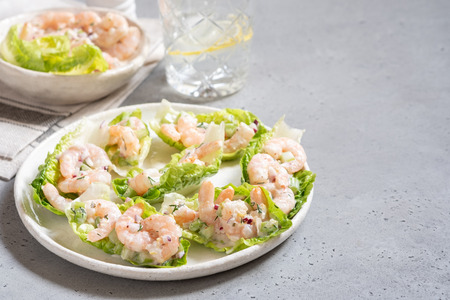 Shrimp salad wraps in lettuce leaves