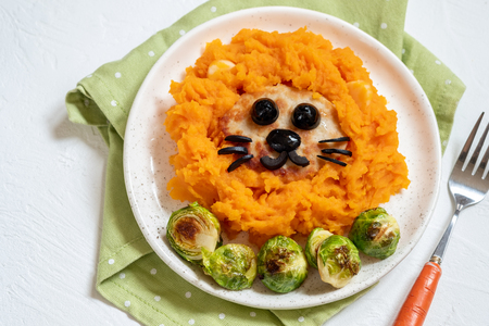 mashed sweet potatoes and turkey cutlet for kids lunch Stock Photo
