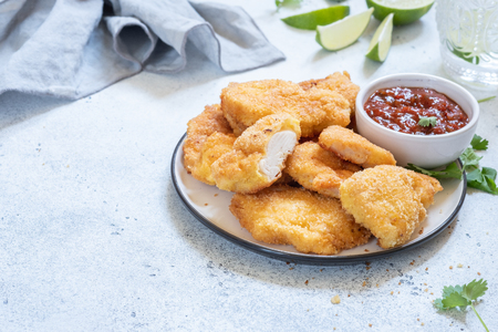Fried crispy chicken nuggets with sauce