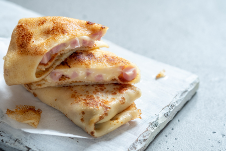 Crepes with ham and cheese Фото со стока