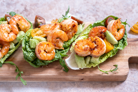 Lettuce wrapped Shrimp tacos with fresh tomato and avocado