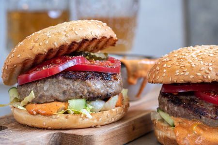 Two delicious homemade burger with beef, tomatoes and cucumber
