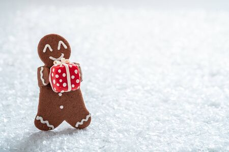 Gingerbread cookie men with tiny marzipan snowman